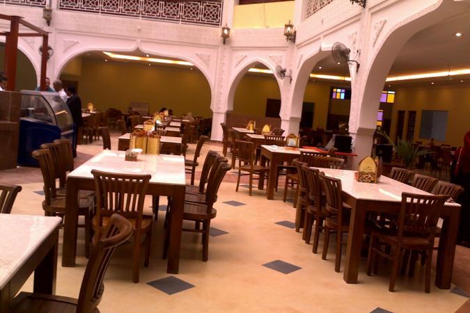 restaurants furniture Al Rawsha Restaurant CONCORDE CHAIR - KOORG MARBLETOP TABLE